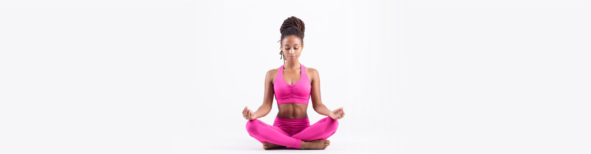 Pretty young happy black woman doing yoga exercise isolated on white background